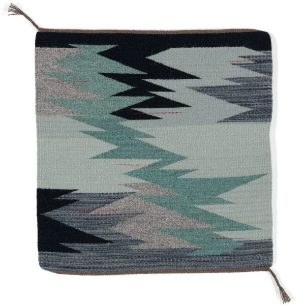 June Opens studio. Regina Design Life Lines square handwoven wool.