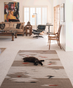 Nee Nee on her custom rug by Regina Design. 10 reasons to buy a rug you'll never throw out